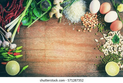 Asian cuisine ingredients food, top view spice lemon grass onion garlic chili ginger for cooking original eastern foods style on top wood texture, space Kitchenware background Thailand food spices
