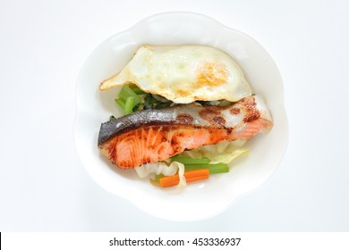 Asian cuisine, pan fried salmon fish served with vegetable and egg
