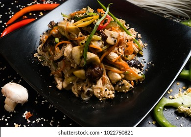 asian cuisine restaurant food menu. chicken mushroom vegetable salad on a plate.