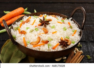 Asian cuisine -vegetarian fried rice with basmati rice and fresh  vegetables.Selective focus photograph,
