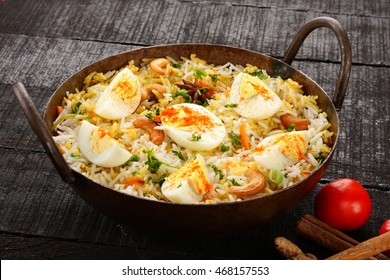 Asian cuisine-Basmati rice egg biriyani or pilaf with Indian spices and herbs,Selective focus photograph