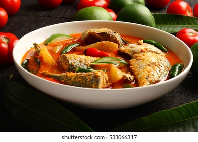 Asian cuisine-coconut milk seafood curry with mangoes and spices,
