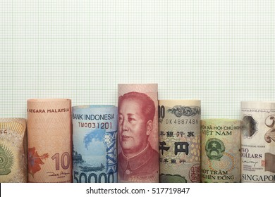 Asian currencies forming a graph against grid background