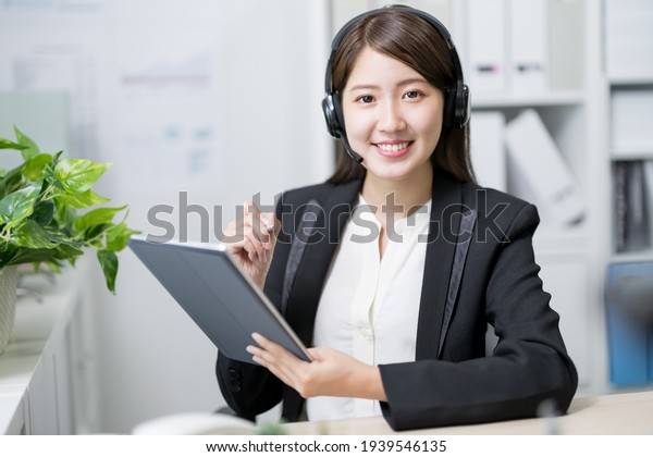 asian customer service representative work and smile at you in the office
