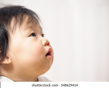 Asian cute baby girl  looking up