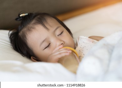 Asian cute baby girl sleeping on the bedroom background.