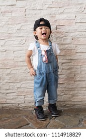 Asian cute baby kid happinese on white brick wall background, portrait child concepts.