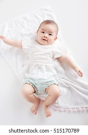 Asian cute baby photography in the studio,Shot from overhead on a white background.