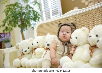 asian cute frowning baby with bears ,