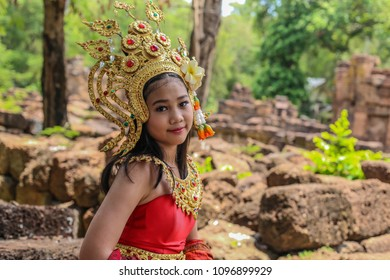 dccde0e9385e2 Asian cute girl beautiful smile face Apsara Thailand in the old temple  green background