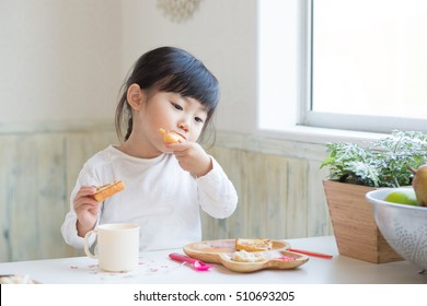 asian cute girl eating toast