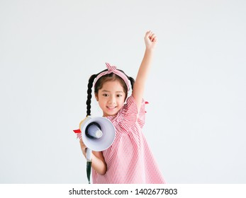 Asian cute girl with megaphone singing on white background