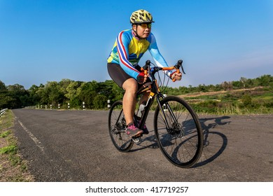 Asian cyclists are cycling.