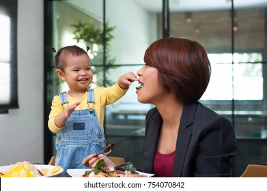 Asian daughter is feeding the mother,Asian mom happy with her daughter at breakfast time,enjoy eating