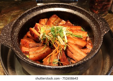 Asian delicacy - Steamed Pork Belly nicely arranged in a pot, ready to be served to customers