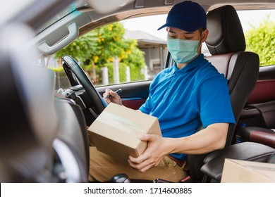 Asian delivery courier young man driver inside the van car with parcel post boxes checking amount he protective face mask, under curfew quarantine pandemic coronavirus COVID-19