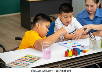 Asian disability child boy and Autism kid learning drawing in classroom