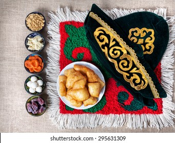 Asian dishes on the ethnic carpet in yurta