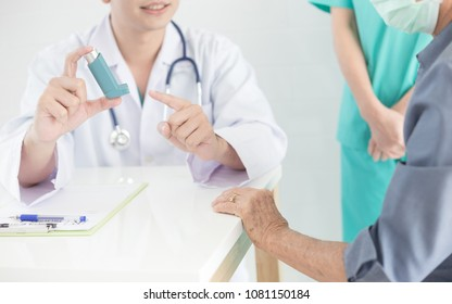 asian doctor explain about how to use inhaler medicine, asthma clinic, elderly disease
