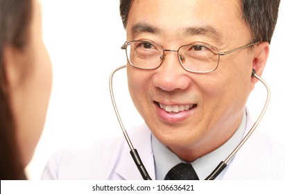 Asian doctor with his patient on white background
