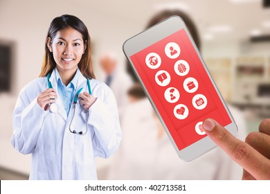 Asian doctor holding stethoscope against pretty science student smiling at camera