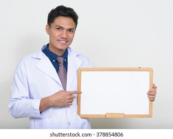 Asian doctor holding white board