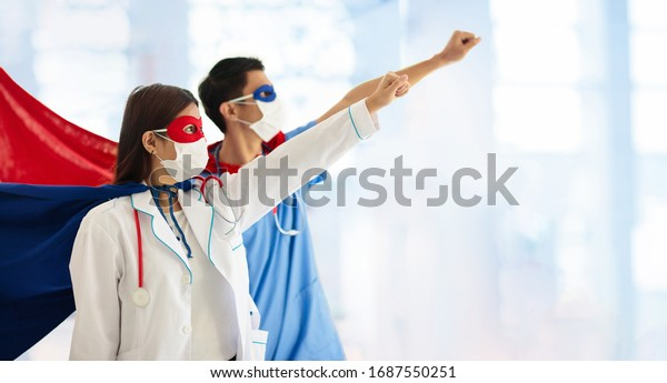 Asian doctor or nurse wearing surgical face mask in superhero cape. Medical staff during coronavirus outbreak in Asia. Super hero power for clinic and hospital personal.