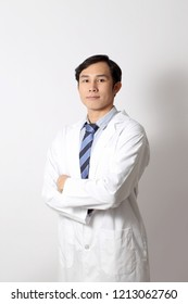 The Asian doctor standing on the white background.