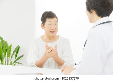 Asian doctor talking to the patient