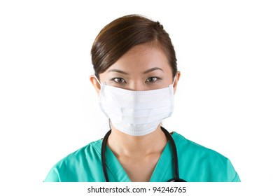 Asian doctor's wearing a face mask, green scrubs and stethoscope.