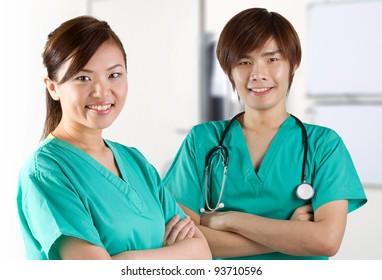 Asian doctor's wearing a green scrubs and stethoscope.