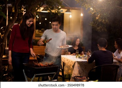 Asian are doing barbecues and party at night