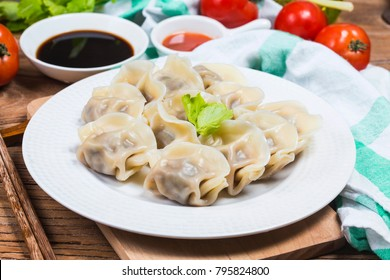 Asian dumplings in bowl, chopsticks, Chinese dumplings for dinner.Chinese dumplings for dinner/lunch. Traditional Asian/Chinese cuisine.