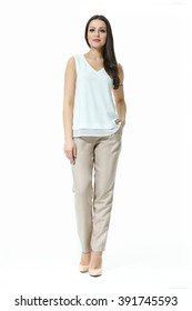 asian eastern brown hair business executive woman with straight hair style in coffee cream summer sleeveless blouse and trousers  high heel shoes going full body length isolated on white