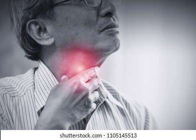 Asian elder old man Sore throat irritation and have a phlegm hand touching neck with red sign.