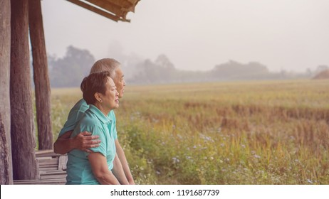 Asian elderly couple at argriculture farm rice field business happy nature lifestyle