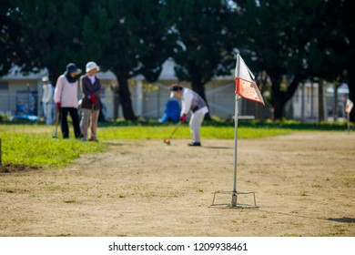 Asian elderly play ground golf
