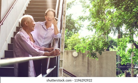 Asian elderly professional couple talking outdoor morning in modern building