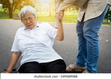Asian elderly woman fell to the floor after tripped over something,female caregiver or daughter help,care,support to her in nursing home,sick senior mother skid,falling down because of dizziness,fain