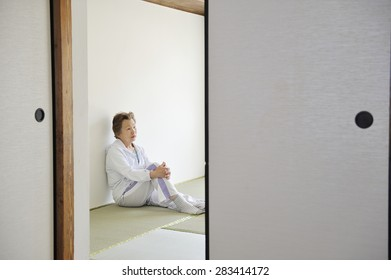 Asian elderly women who are sitting in the Japanese style of the room alone