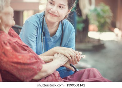 Asian eldery  woman with her caregiver at home. Home care or Elderly care concept.