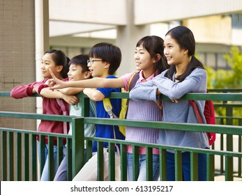 asian elementary school children having a good time together.
