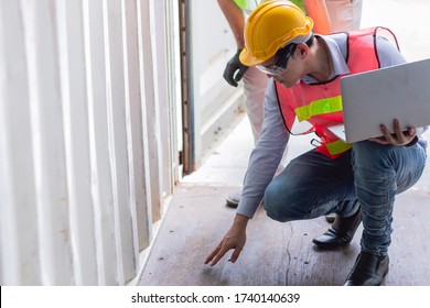 Asian Engineer checking floor strength condition of cargo container interior for safety according to international rule and Intermodal containers standard.