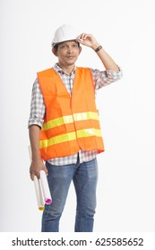 Asian engineer holding paper rolls, wearing helmet and vests, standing on white background