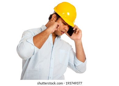 Asian engineer man can't hear his phone stop an ear  try to listen to the phone isolated on white background