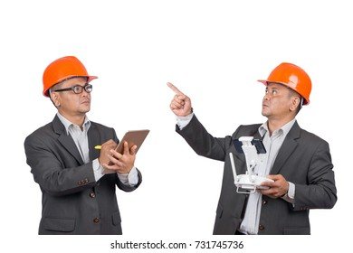 Asian engineer men using tablet and play drone with remote control isolated on white background.