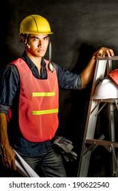 asian engineer on black background