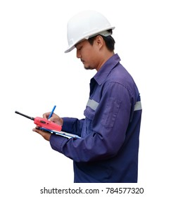 Asian engineer in safety uniform and white helmet taking note on clipboard isolated on white background for industrial concept