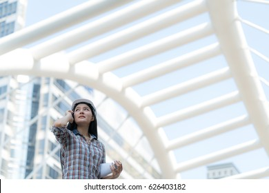 Asian Engineer Woman on activity in Site construction project