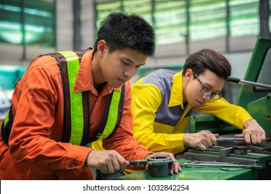 Asian engineer and worker setting machine for process metal job, this immage can use for job, working, man, factory, maintenance, engineering factory and manufacturing process